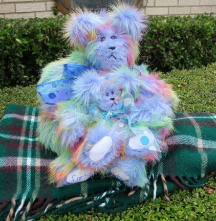 Blue rainbow bear and baby (624x640)